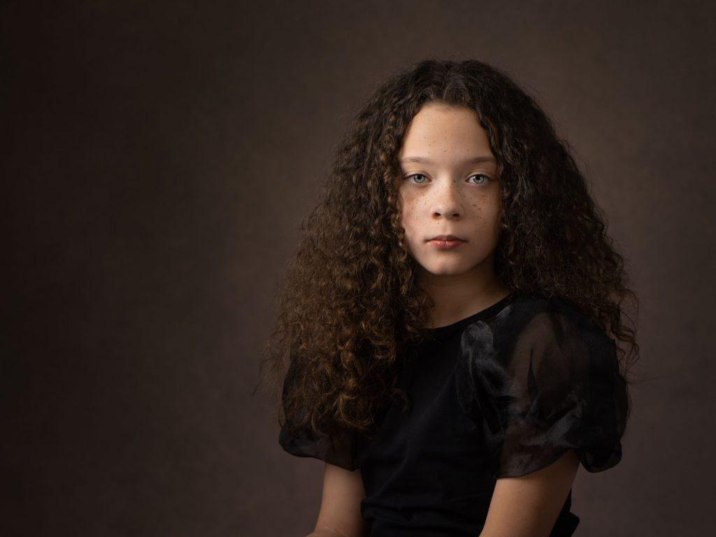 freckled beautiful girl with dark hair fine art photoshoot