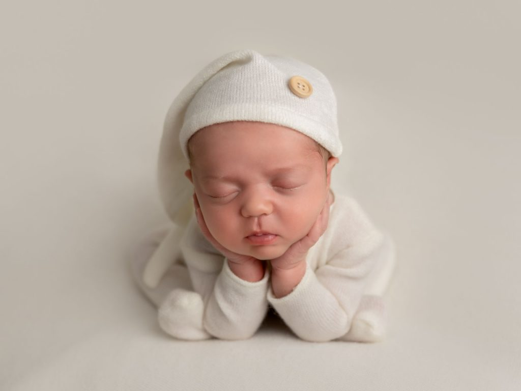 Newborn baby asleep in night outfit
