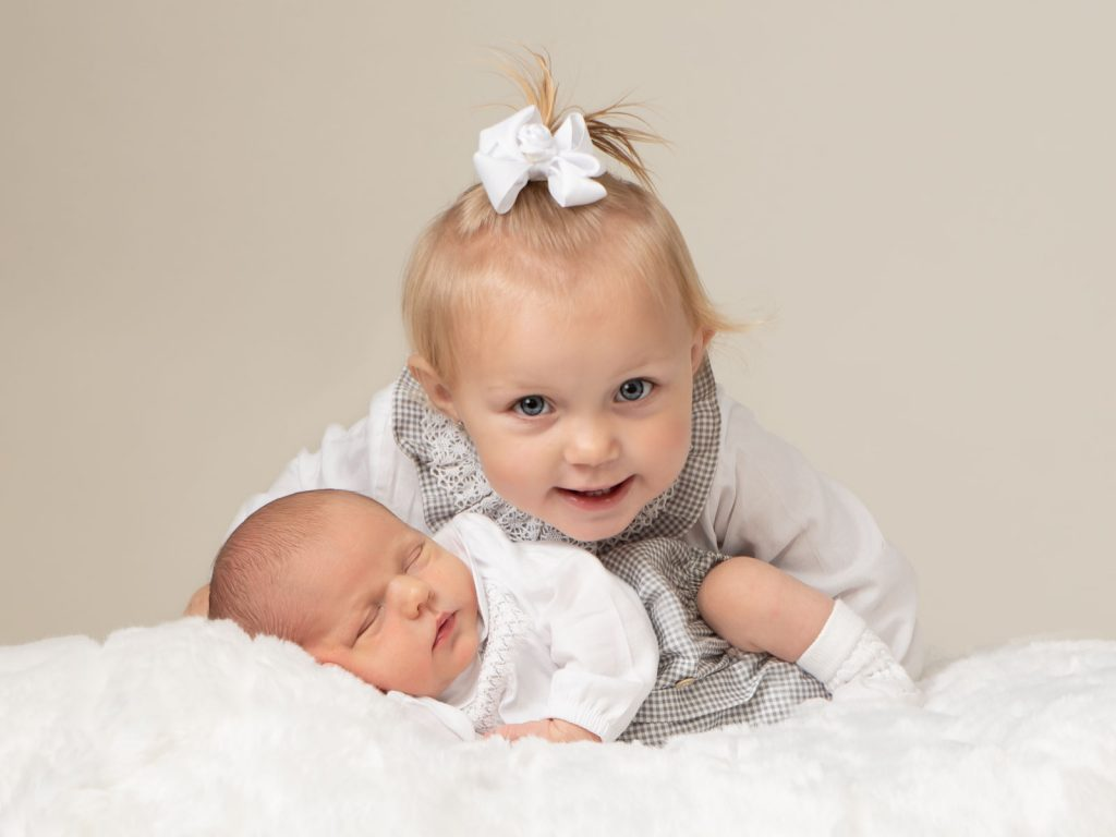 newborn baby with older sibling