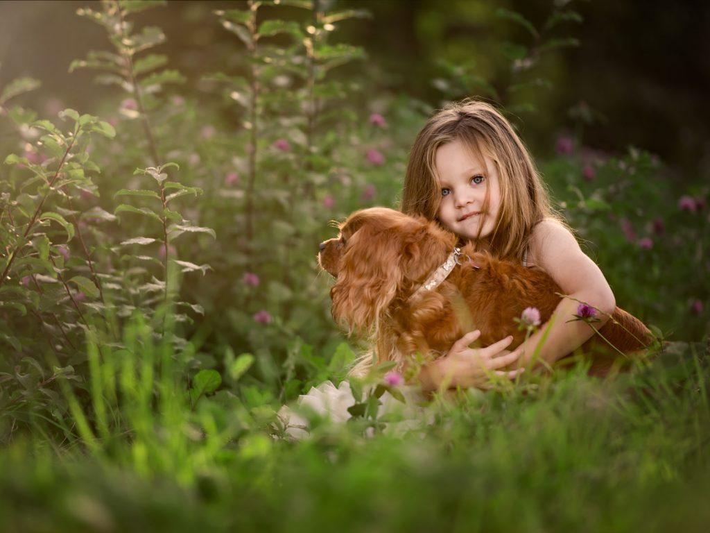 child holding her dog location photoshoot