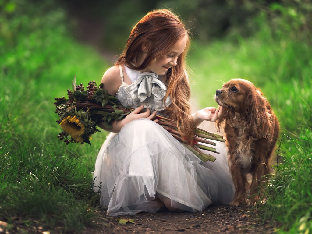 child in stunning dress and her dog location photoshoot