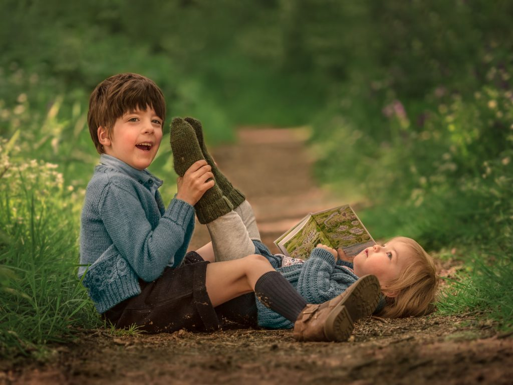 two children playing outdoors location photoshoot
