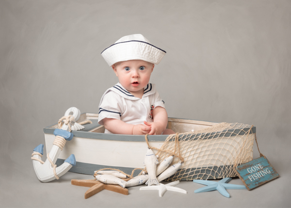 boy in a boat photoshoot