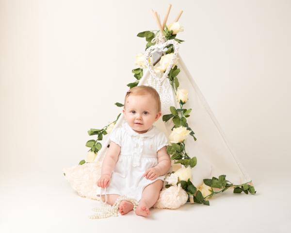 innocent in white baby photoshoot
