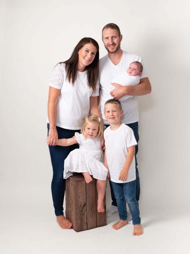 white tops a whole family with children and newborn baby together