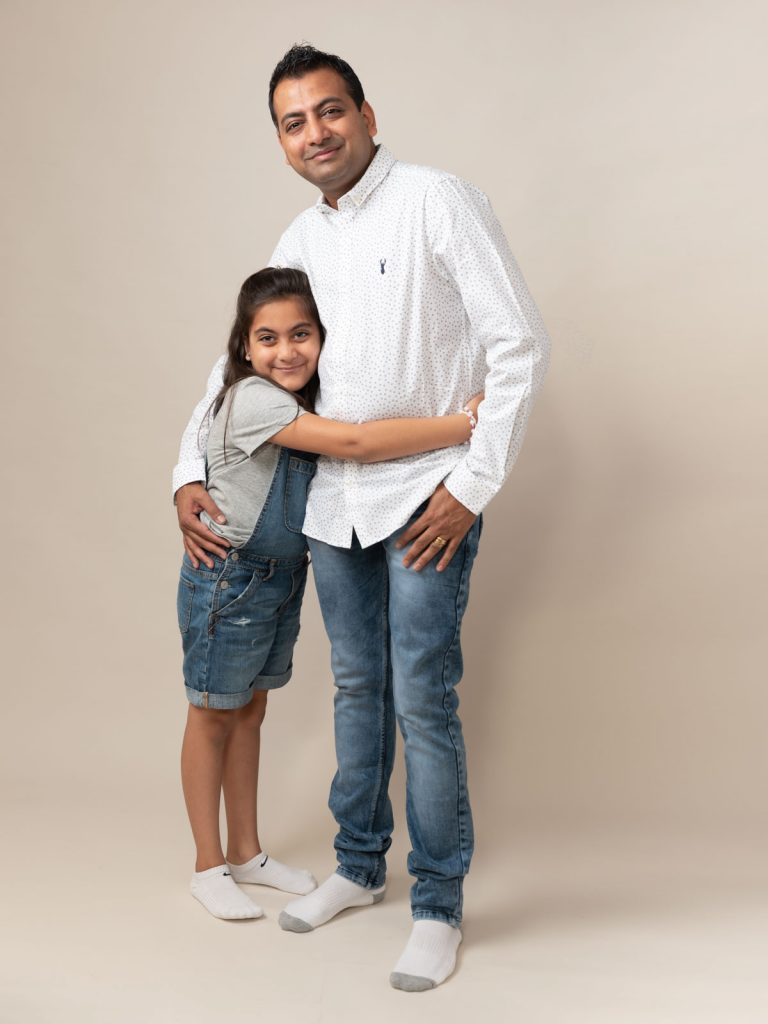 denim themed girl and her dad hugging