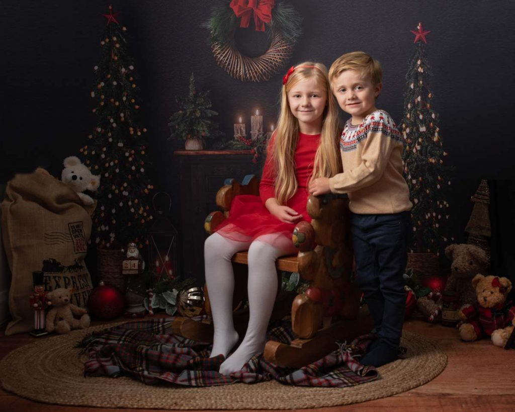 brother and sister with Christmas jumper
