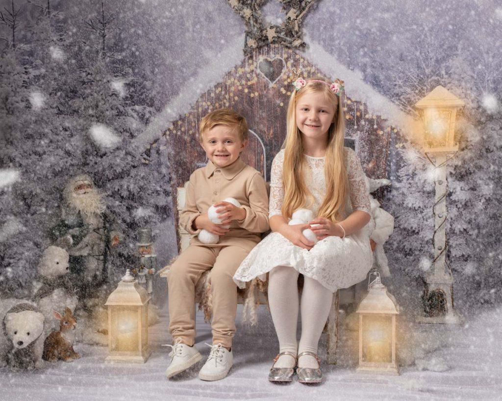 snowball making brother and sister Christmas photoshoot