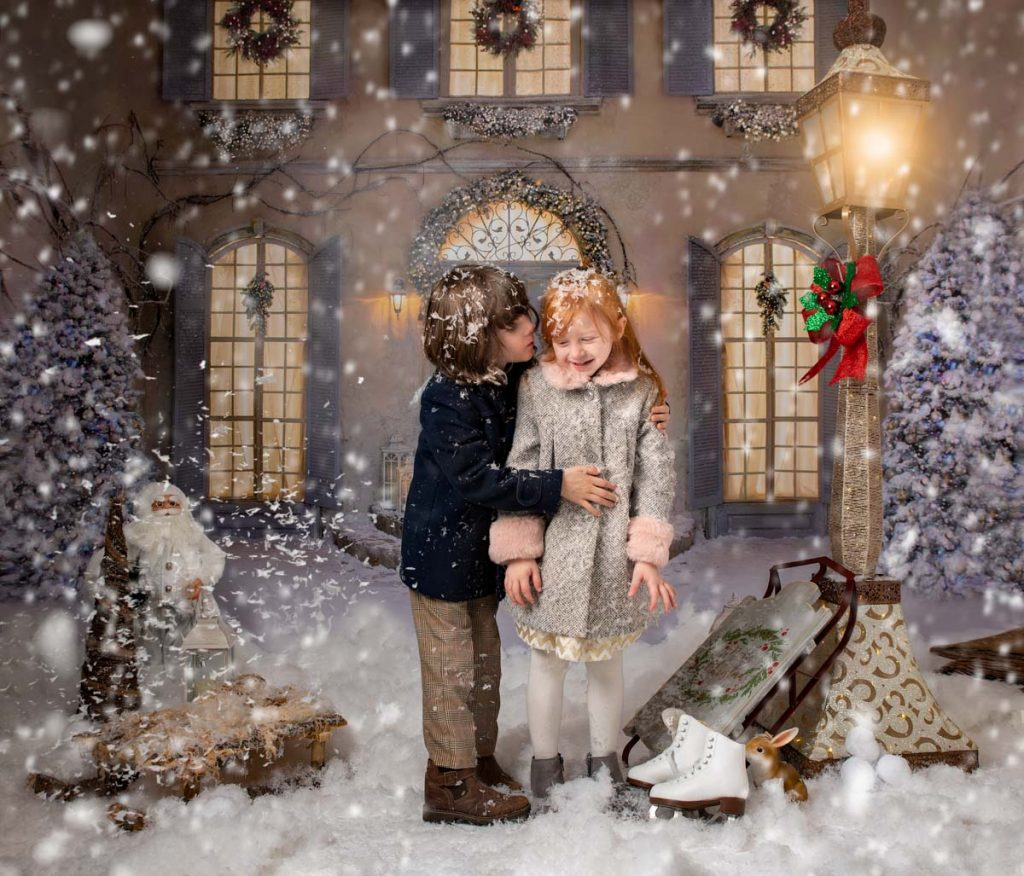 boy kissing girl outside in the snow