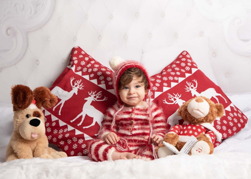 red and white themed child Christmas photoshoot