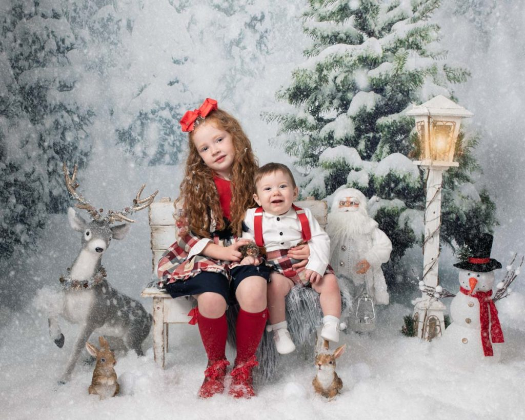 brother and sister in Narnia Christmas photoshoot