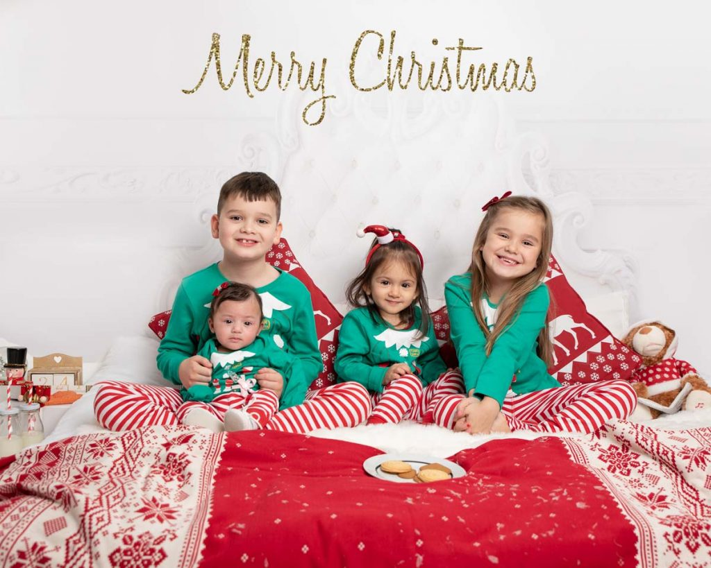 in bed waiting for Santa as a family Christmas photoshoot