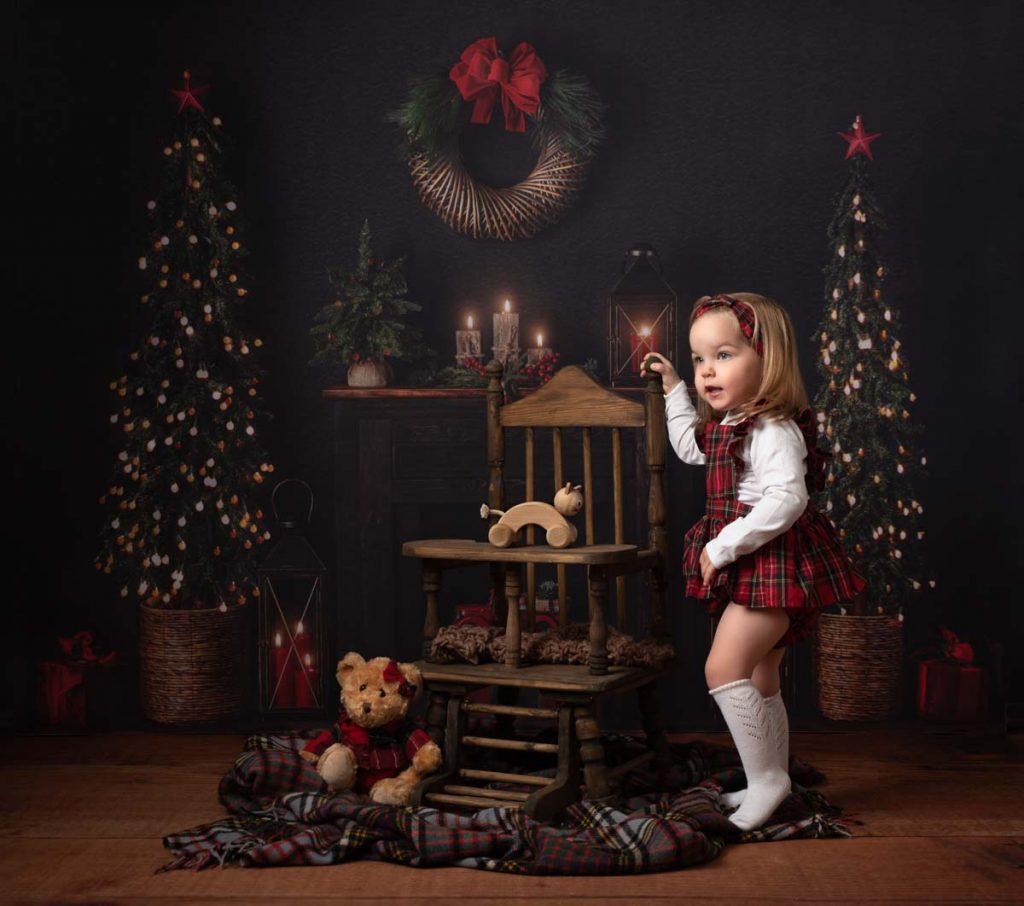 little girl with her Christmas teddy bear fine art Christmas photoshoot