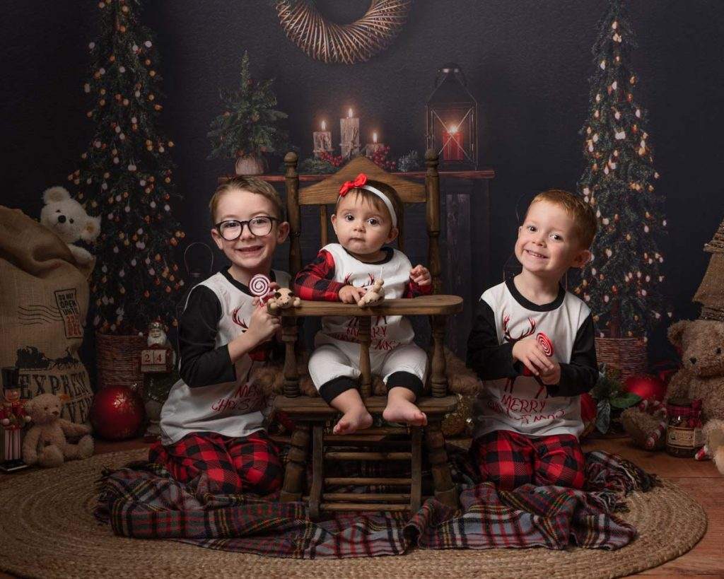 little toddler with her two brothers excited for Santa