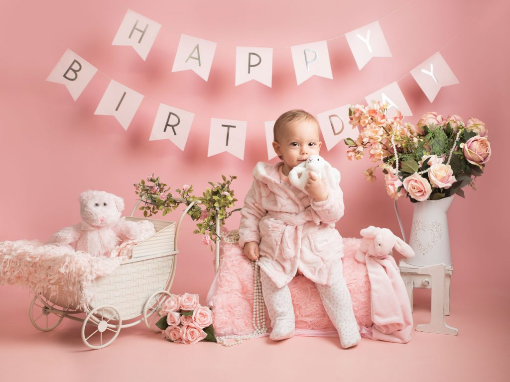 baby and bear in a pink setting cake smash photography