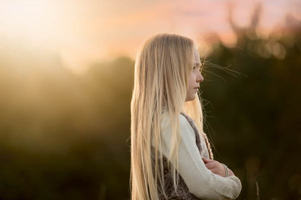 young girl with blonde hair outside location shoot
