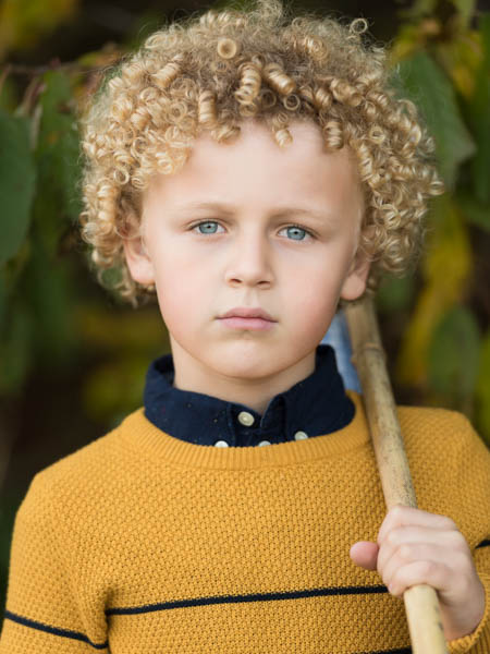 outdoor location photoshoot with young boy in autumn portrait photo