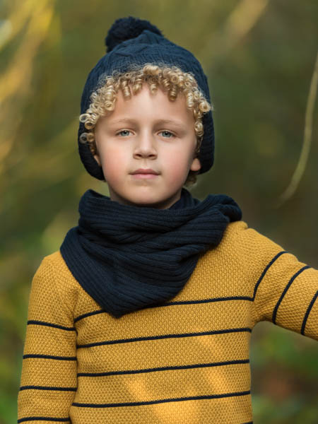 outdoor location photoshoot with young boy in autumn closeup