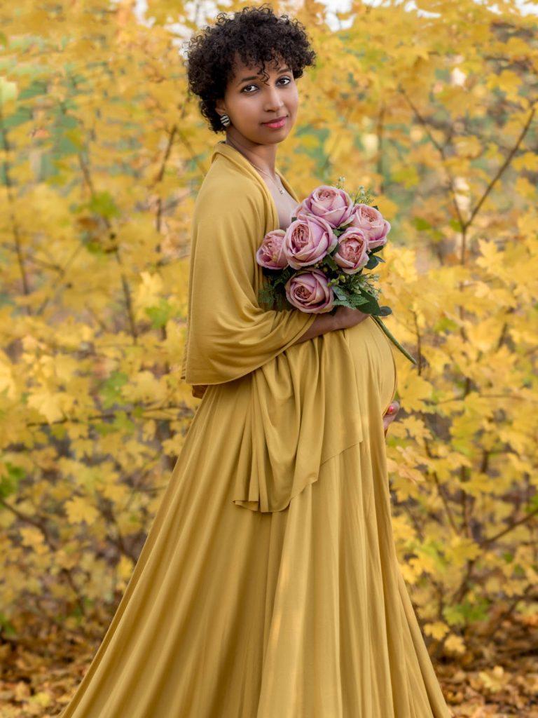 stunning mustard dress with roses maternity photoshoot