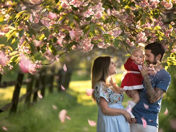 parents and baby photoshoot with trees