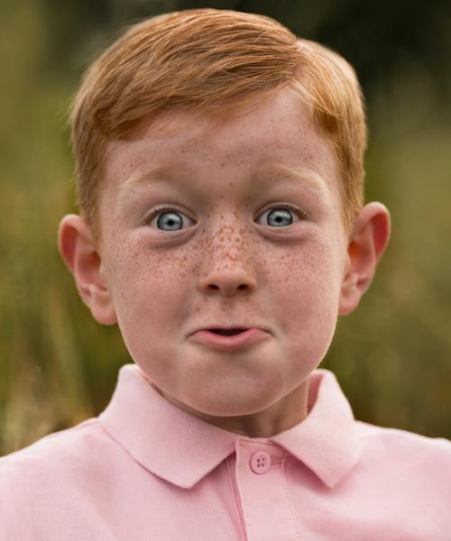 redhead boy looking surprised
