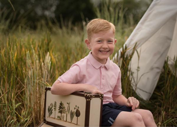 red hair boy camping