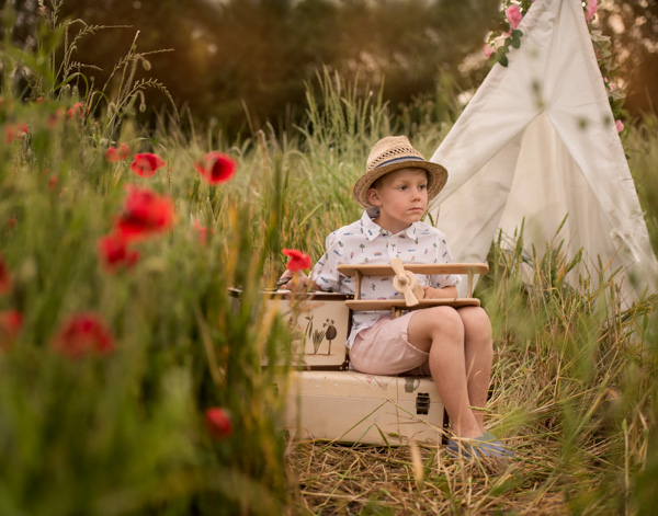 baby in a hat camping