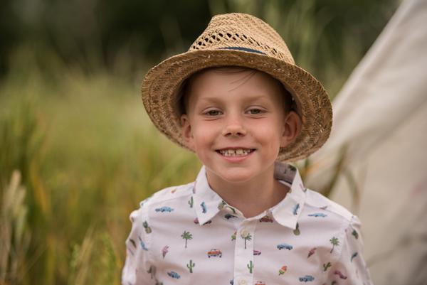 boy in a hat in a field