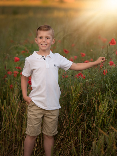 boy with poppies outdoor photography