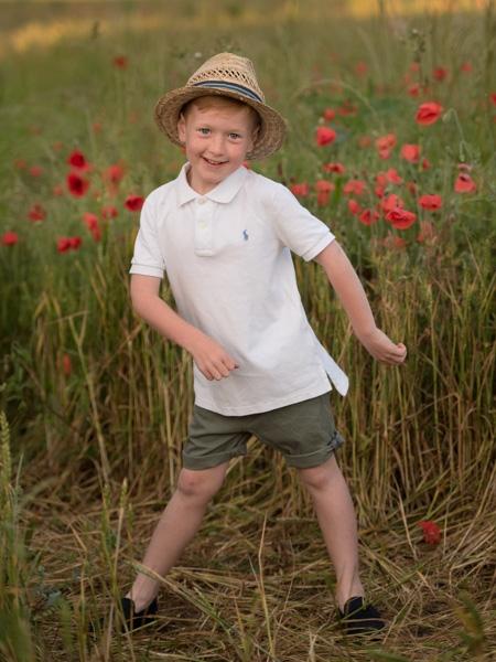 boy flossing in a field