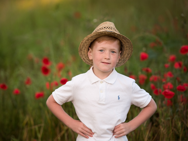 boy in a hat in a field outdoor photography