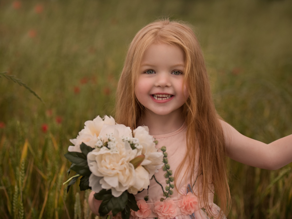 girl with long blond hair and flowers