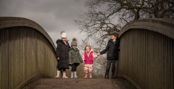 family on a bridge outdoor photo session