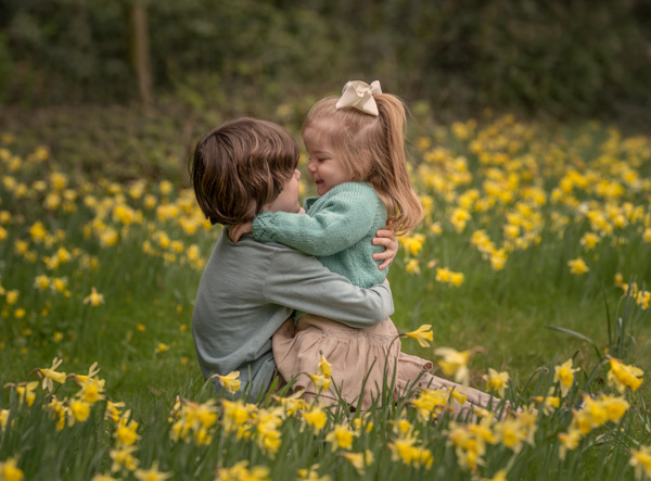 two children in a field of daffodils