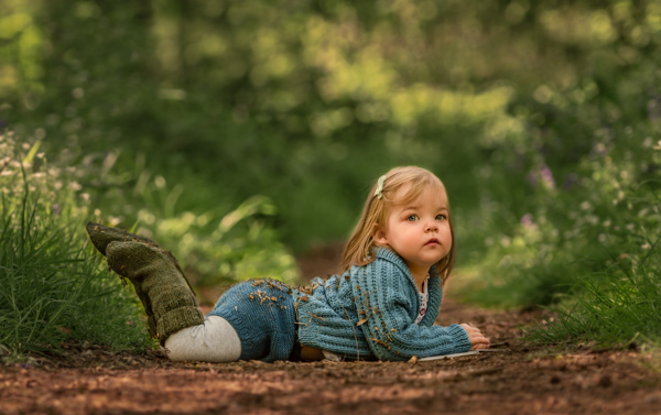 girl lying on floor for outdoor photography session