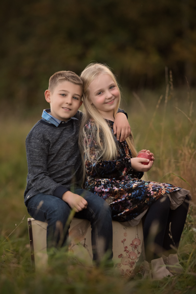 boy and girl in a field