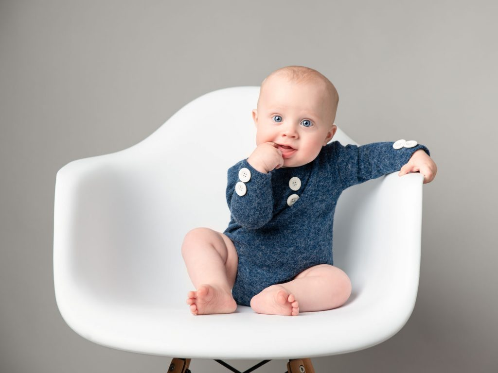 baby sitting alone in a chair
