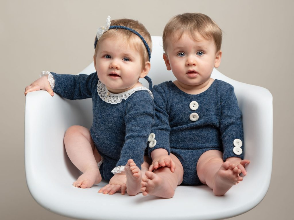 twin babies sitting together