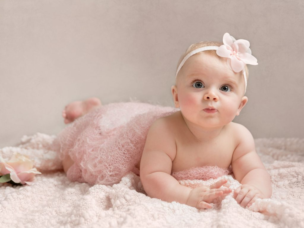 baby with beautiful pink setting