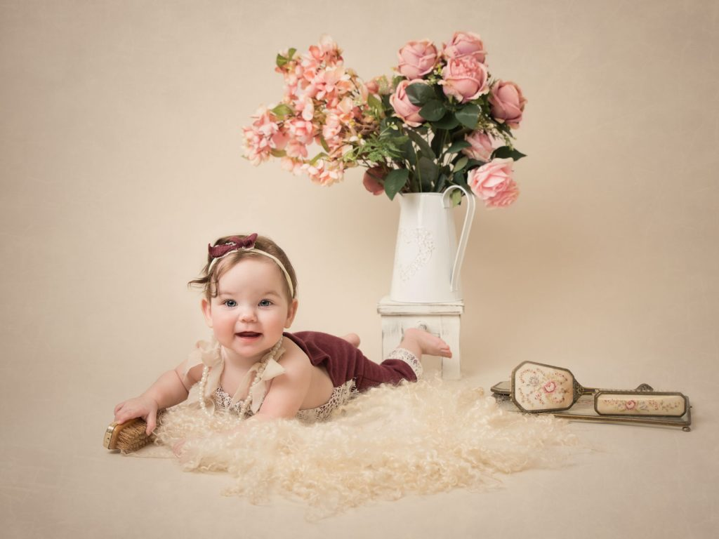 baby sitting up with floral decoration