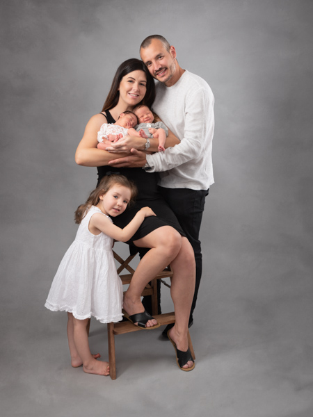whole family with their newborn baby