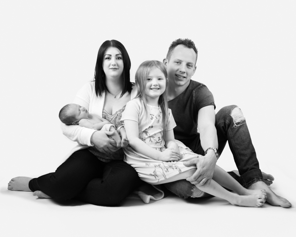 mother father and two children studio photoshoot