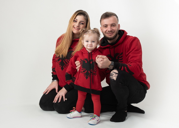 Mother, Father and their lovely daughter all wearing matching clothing