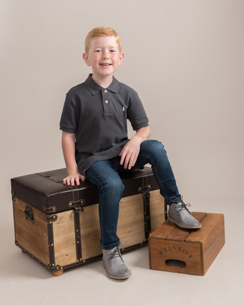 young boy sitting with smart clothing