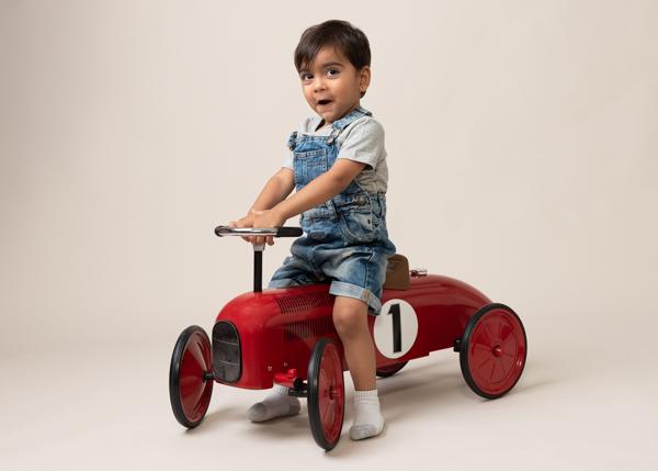 boy enjoying his new toy car