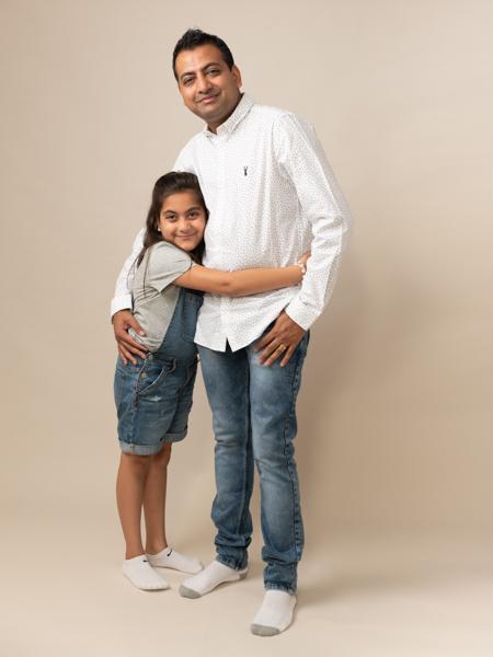 girl hugging her dad in the studio