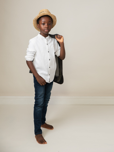 boy with his straw hat stunning photoshoot