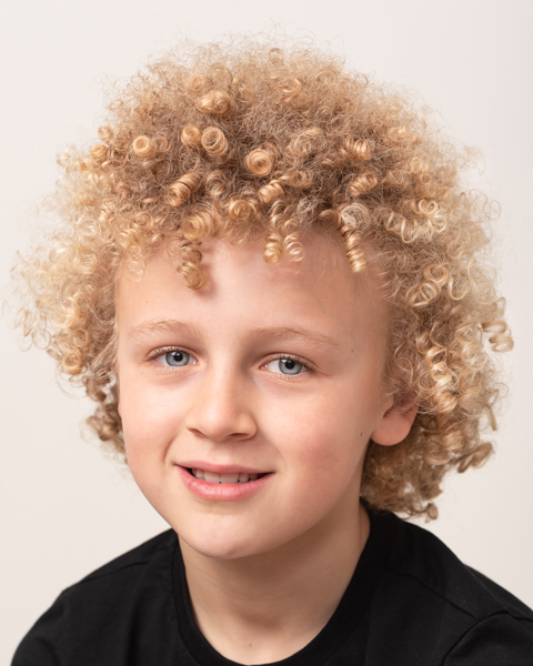 close of up kid's face and curly hair