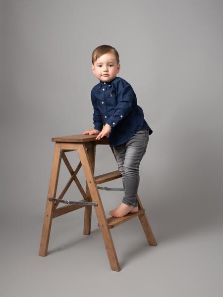 young boy climbing a ladder