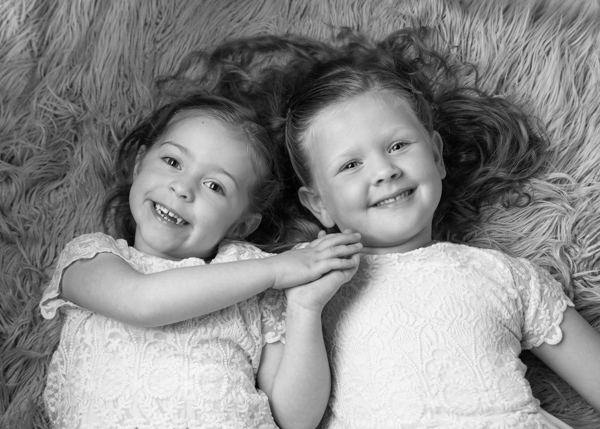 black and white photo of two girls